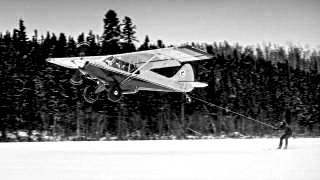 Airplane pulling skier on snow.jpg