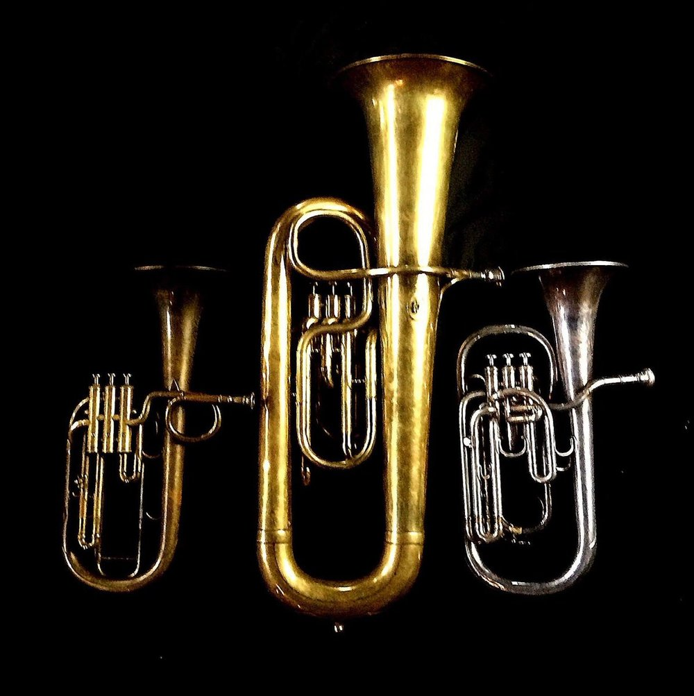 Left to Right: Tenor saxhorn in F/E flat/D by Antoine Courtois (Paris, c. 1855), sold by Arthur Chappell (London), Contrabass saxhorn in E-flat by E. Daniel (7167, Marseille, c. 1850), Tenor saxhorn in E-flat by Boosey & Co (47317, 295 Regent Street, London, 1900).