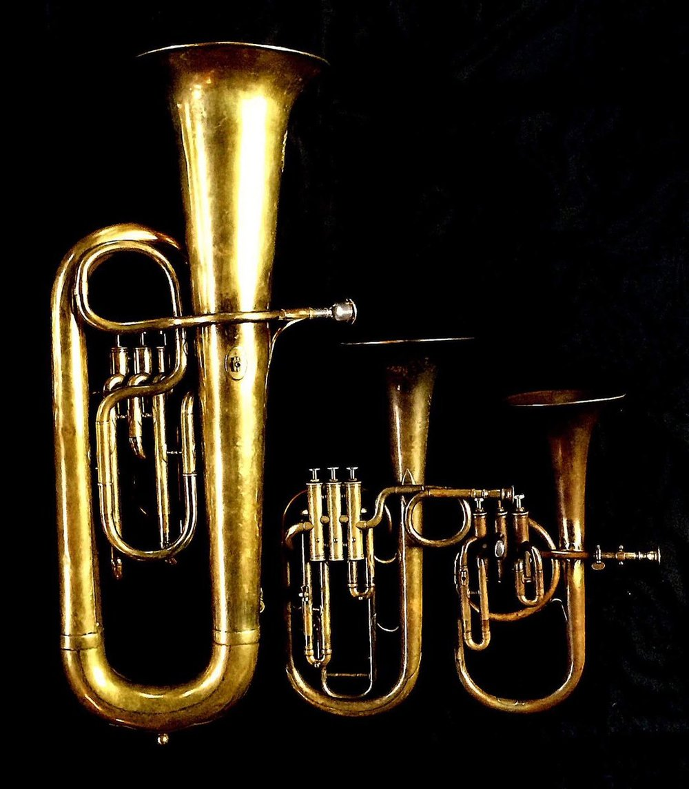 Left to Right: Contrabass saxhorn in E flat by E. Daniel (7167, Marseille, c. 1850), Tenor saxhorn in F/E flat/D by Antoine Courtois (Paris, c. 1855), sold by Arthur Chappell (London), Contralto saxhorn in B-flat by J. Grass (32 Rue des Ponts de Comines, Lille, est. 1868.