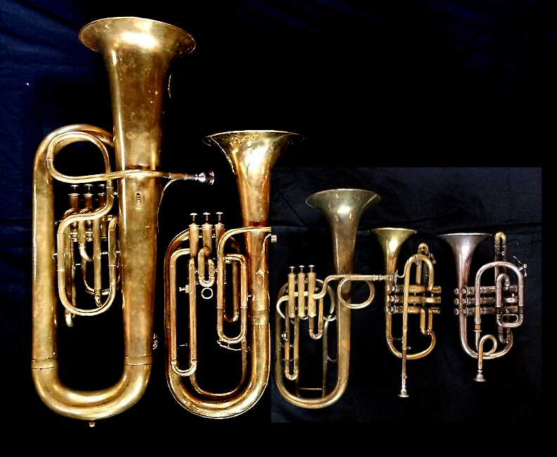 Left to Right:  Contrabass saxhorn in E-flat by E. Daniel (7167, Marseille, c. 1850), Baritone saxhorn in B-flat by Couesnon (44139, 94 Rue D'angouleme Exposition Universelle De Paris, 1900), Tenor saxhorn in F/E flat/D by Antoine Courtois (Paris, c. 1855), sold by Arthur Chappell (London), Cornet in E-flat by Couesnon (94 Rue D'angouleme Exposition Universelle De Paris 1900), Cornet in C/B-flat by Henry Distin New American Model (9580, Williamsport, PA, c. 1895),.