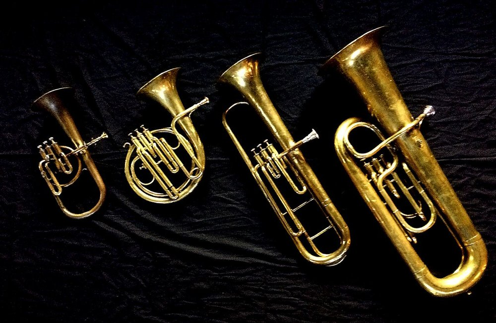 Left to Right: Contralto saxhorn in B-flat by J. Grass (32 Rue des Ponts de Comines, Lille, est. 1868), Ventilhorn in E-flat by Distin (4760, Gt. Newport Street, London, c.1862), Baritone saxhorn in C/B flat by Couturier (Lyon, c. 1865), Contrabass saxhorn in E-flat by E. Daniel (7167, Marseille, c. 1850).