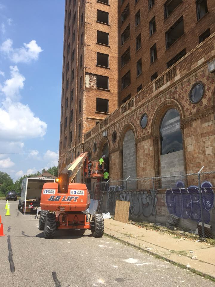 Workers beginning to seal up the property on July 25, 2018. Photo by Eric Hergenreder.