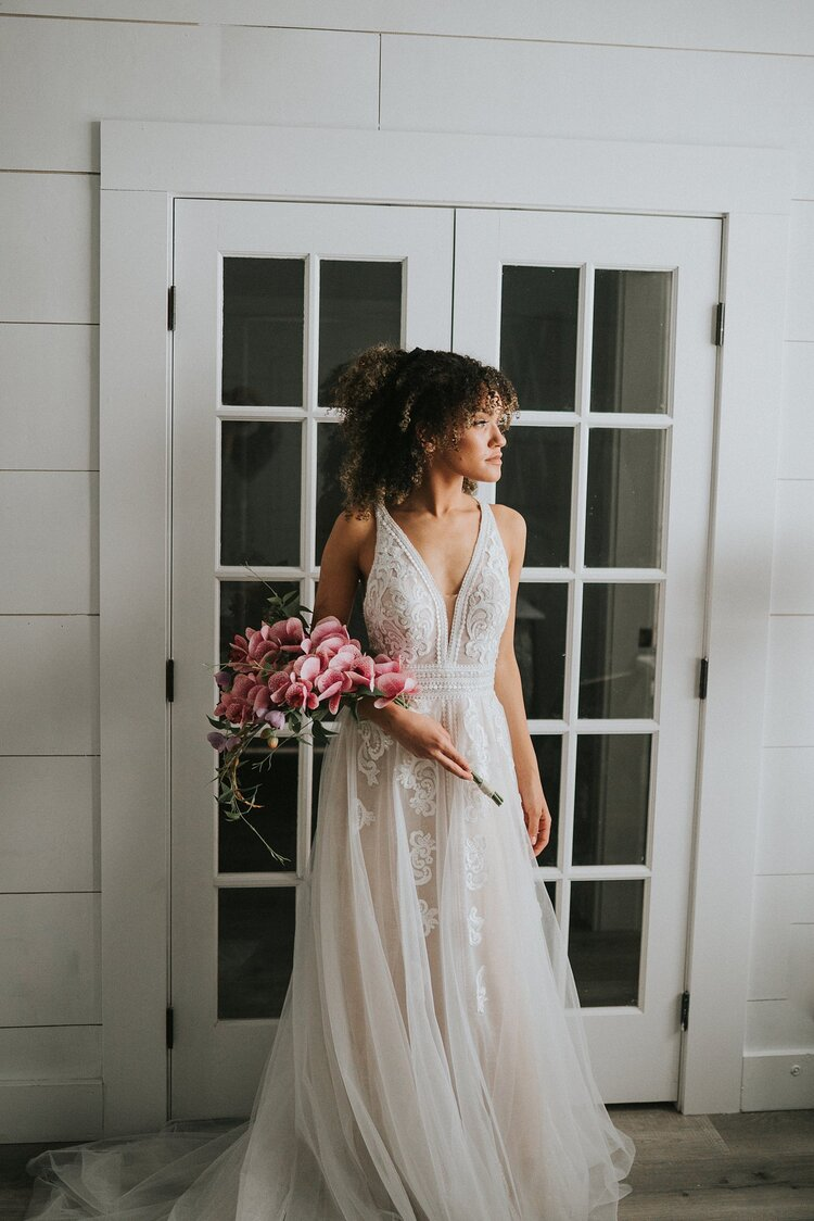 Jackson-hole-wedding-elopement-bridal-arrival-small-bouquet-chiffon-dress-looking-wedding-bride-photographer-knoxville-look-for-the-light-photo-video
