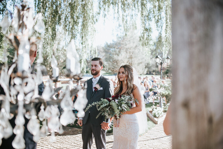 wedding-ceremony-outdoor-venue-summer-chattanooga-bride-and-groom-look-for-the-light