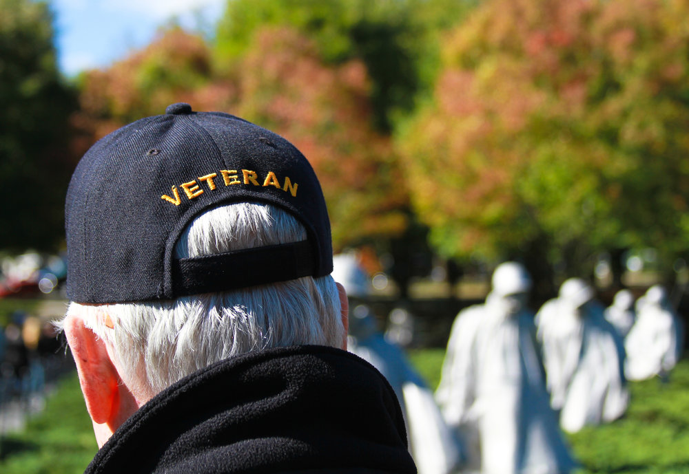 Korean War veteran overlooks the 19 stainless steel statues at the Korean War Veterans Memorial located in Washington D.C.'s West Potomac Park Oct. 22, 2016. The memorial pays tribute to the 5.8 billion Americans who served in the Korean War. More than 36,000 Americans lost their lives in one of the most hard fought wars in American history and an additional 103,284 were injured during battle.