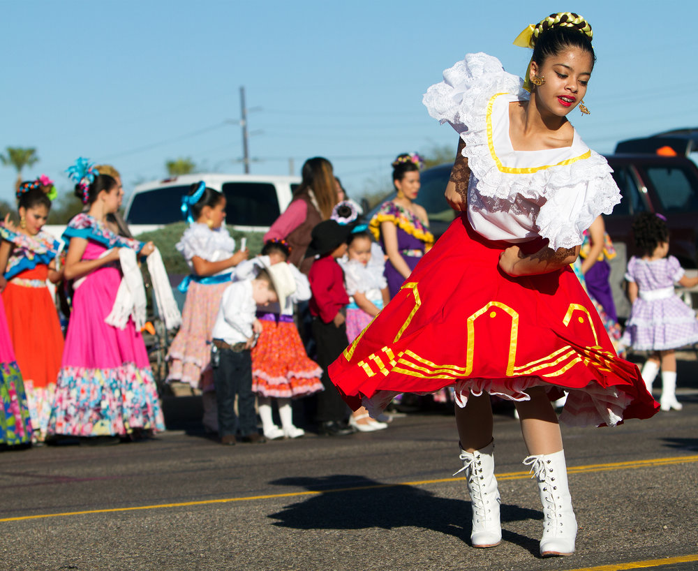 A girl from Viva Performing Arts Center dances Folklorico at the Tucson Rodeo Parade Feb. 23, 2017.