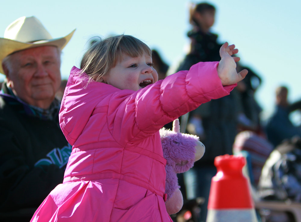 Lily Dimitrov, 4, waves at participants in the Tucson Rodeo Parade Feb. 23, 2017.