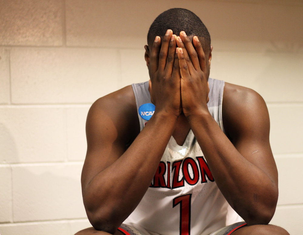 Freshman guard Rawle Alkins sits in the locker room with his head in his hands after Wildcats' 73-71 loss to Xavier Musketeers in the Sweet 16 matchup March 23, 2017.