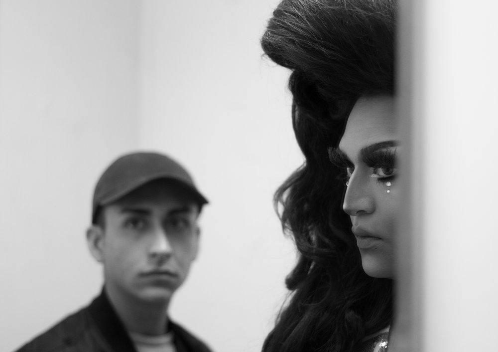 "Raquel Blanco takes one last look in the mirror with boyfriend David before her performance. ""I always get anxiety before a show, but as soon as I open the curtain my eyes get a little lower, I just become a whole different person."""