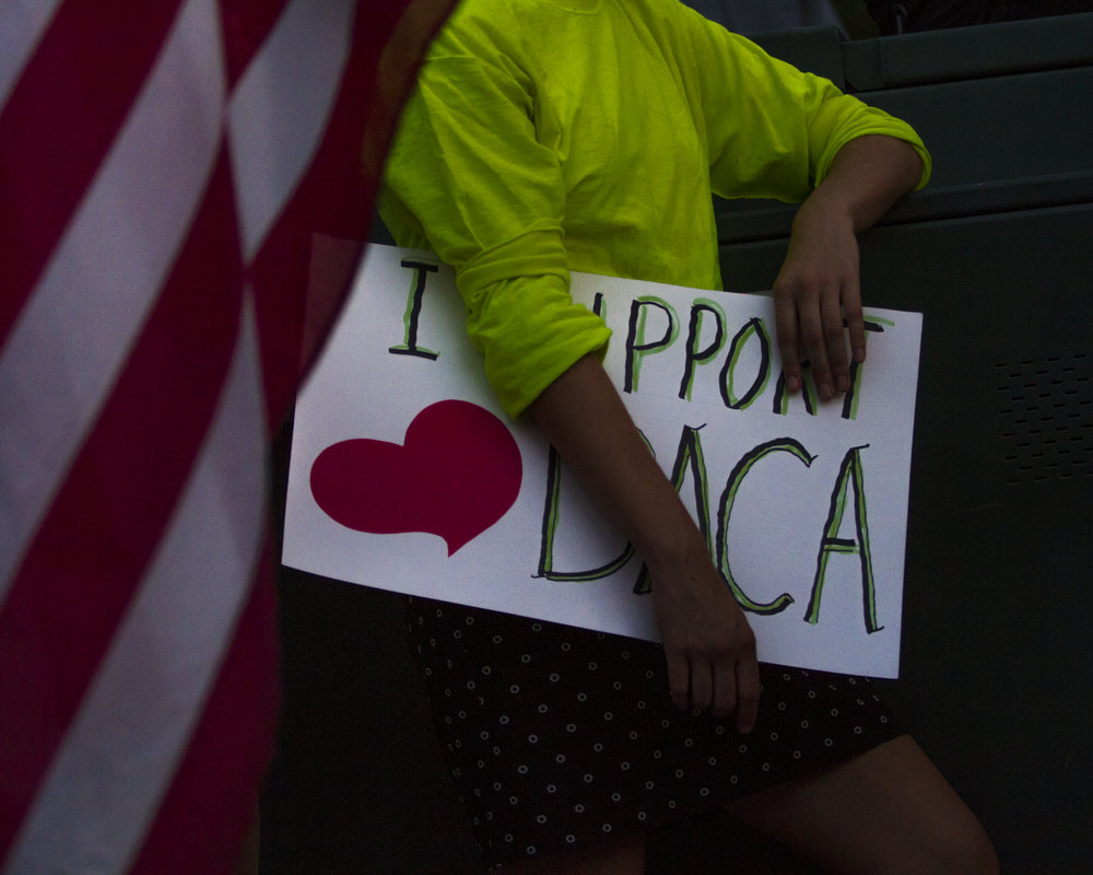 "A participant, who preferred to remain anonymous, holds a sign in support of DACA recipients at the ""Defend DACA! March & Rally"" in Tucson, Ariz. at city hall Sept. 6, 2017."