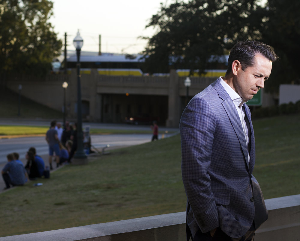A local news anchor gets ready to air live from the Grassy Knoll in Dallas, Texas for a segment on the release of the JFK documents Oct. 26, 2017.