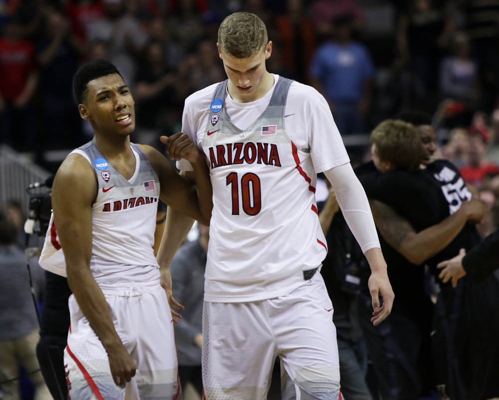 Sophomore guard Allonzo Trier, left, cries to teammate Lauri Markkanen, right, after Wildcats' 73-71 loss to Xavier Musketeers in the Sweet 16 matchup March 23, 2017.