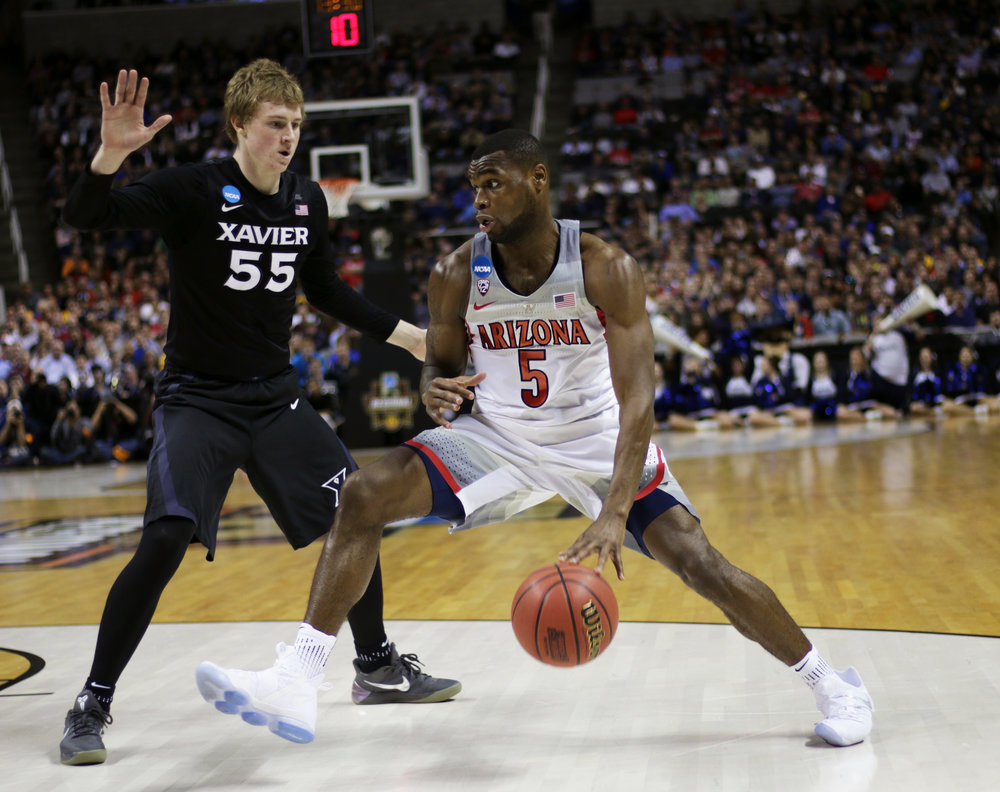 Arizona senior guard Kadeem Allen (5) drives past Xavier guard J.P. Macura (55) during the second half of the Arizona vs Xavier Sweet 16 matchup March 23, 2017. Wildcats lost to Xavier Musketeers 73-71.