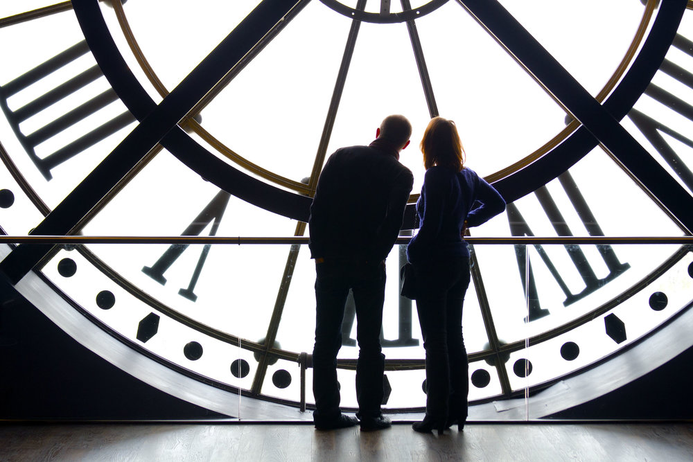 A couple looks out the clock tower at the Musée d' Orsay in Paris, France March 1, 2016.