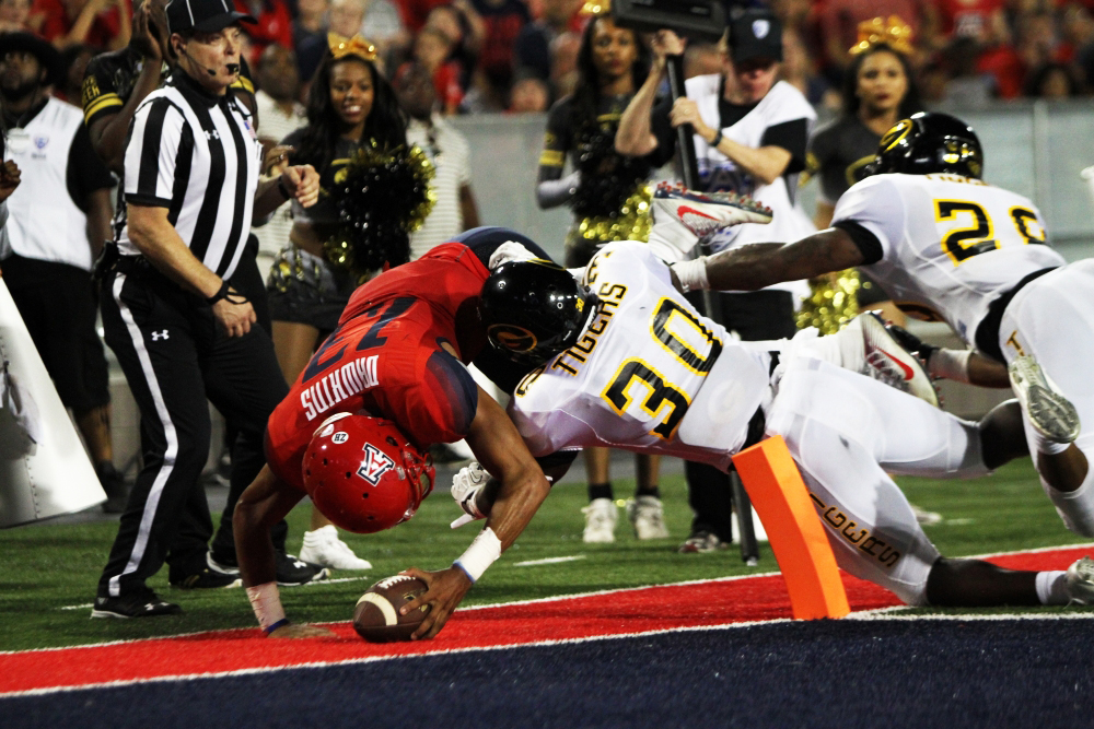 University of Arizona football quarterback Brandon Dawkins (13) scores the first touchdown of the game against Grambling State Sept. 10, 2016. Dawkins ran for two touchdowns and rushed 223 yards leading the Wildcats to victory, 31-21.