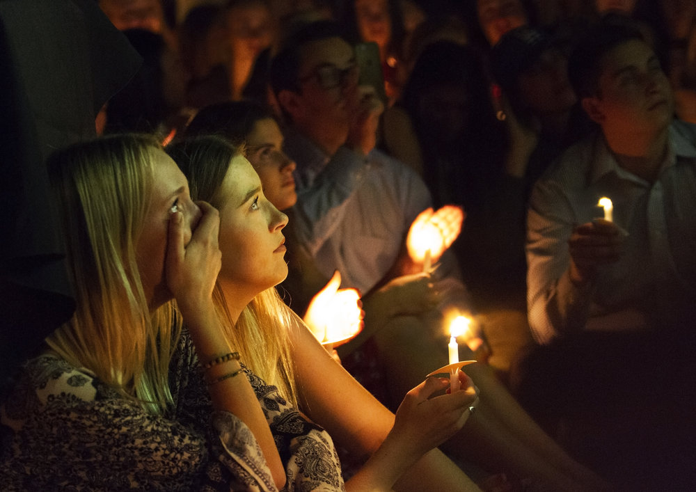 "Close friends of Christiana ""Chrissy"" Duarte, who was killed in the Las Vegas shooting, cry as they watch a slideshow dedicated to Chrissy's life at her memorial service hosted by the Arizona Zeta Omicron chapter of Sigma Kappa sorority at the University of Arizona, Oct. 10, 2017."