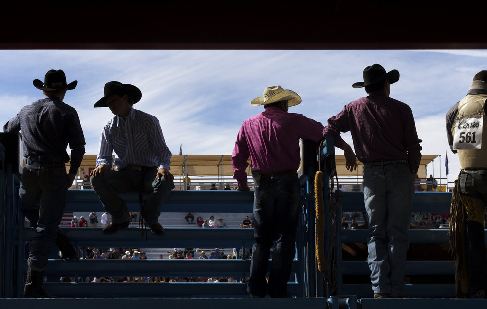 ProRodeo bareback riders line up on the chutes before competing in the 93rd annual La Fiesta de los Vaqueros during opening weekend Saturday, Feb. 17, 2018 in Tucson, Ariz.