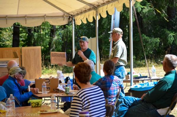 Andy Perleberg presents award to John Henrikson of Wild Thyme Farm