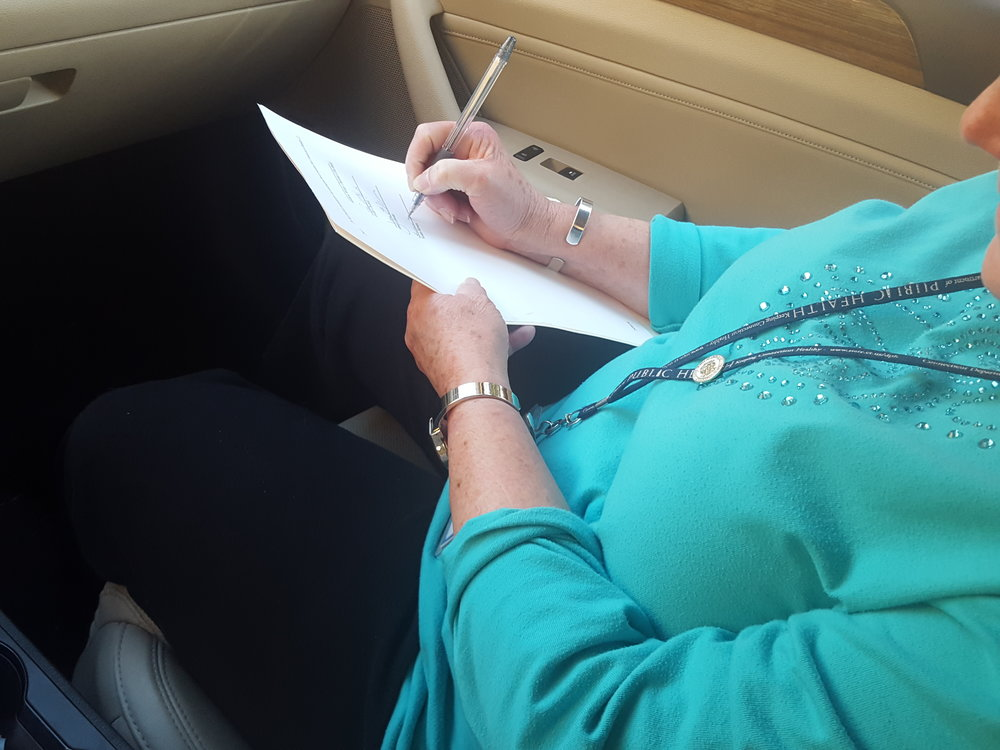 Susan Hewes signs while in the passenger seat of Iran's car :)