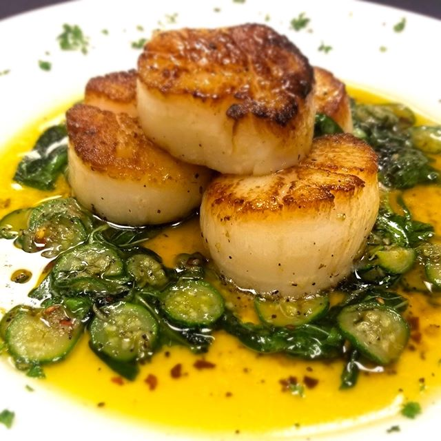 Presenting tonight's dinner special: Capesante Alla Scapecé! Succulent sea scallops sautéed in olive oil with baby zucchini, fresh garlic and basil. Delizioso! Start your weekend celebration with Stino's tonight! 🇮🇹 #stinodanapoli #italianfood #eatitalian #eatlocal #rockyriver #scallops #seafood