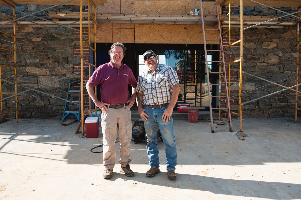 Allen Cochran with builder Tom Greer outside the barn's upper level.