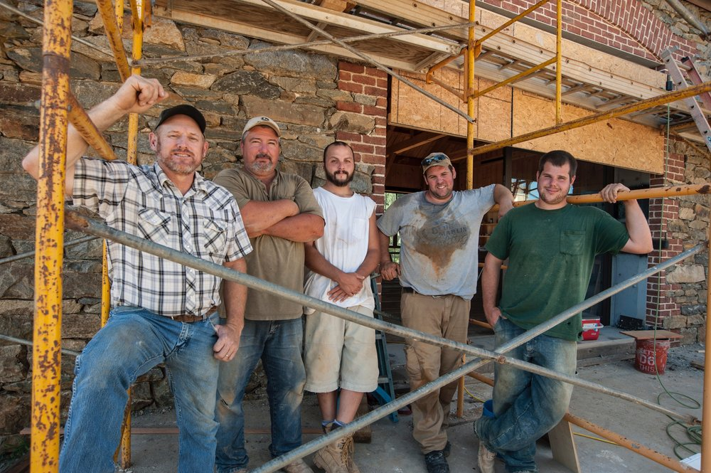 Allen Cochran, masonry manager Will Brown next to Cochran, and Brown's crew on the Little Washington job.