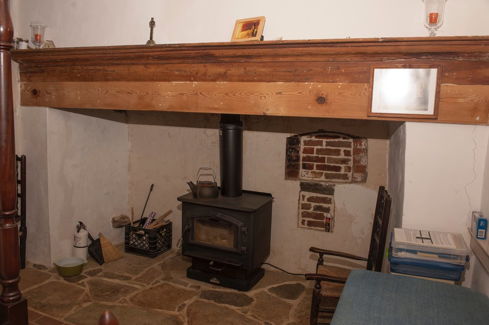 Bedroom fireplace features a bricked-in beehive oven.