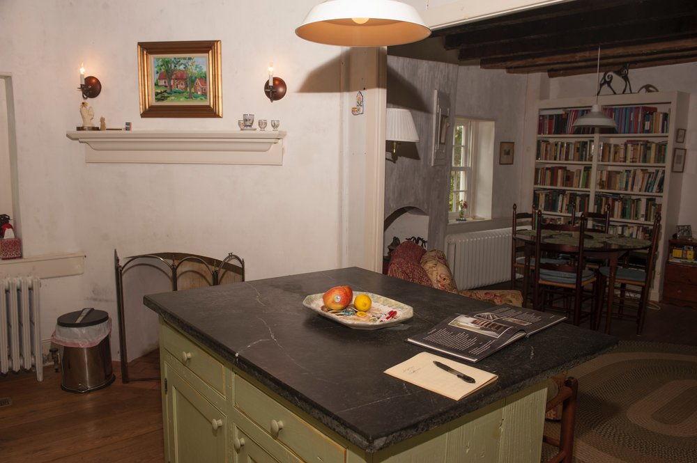 Renovated kitchen features new island and cabinets built to suit a 1740s structure.