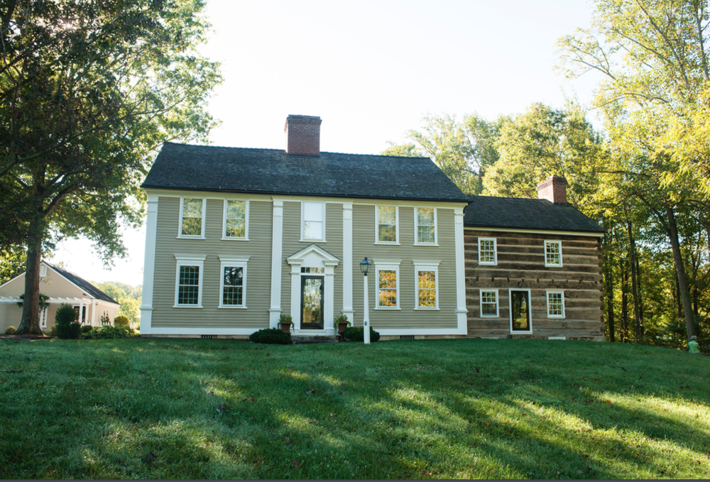 The Crofts moved the Greek Revival house from New England and restored it here. Cochran's reconstructed and custom-designed the log addition.