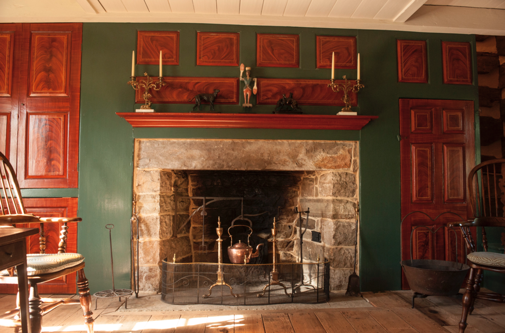 Handsome main fireplace is surrounded by cabinetry found by the Crofts.