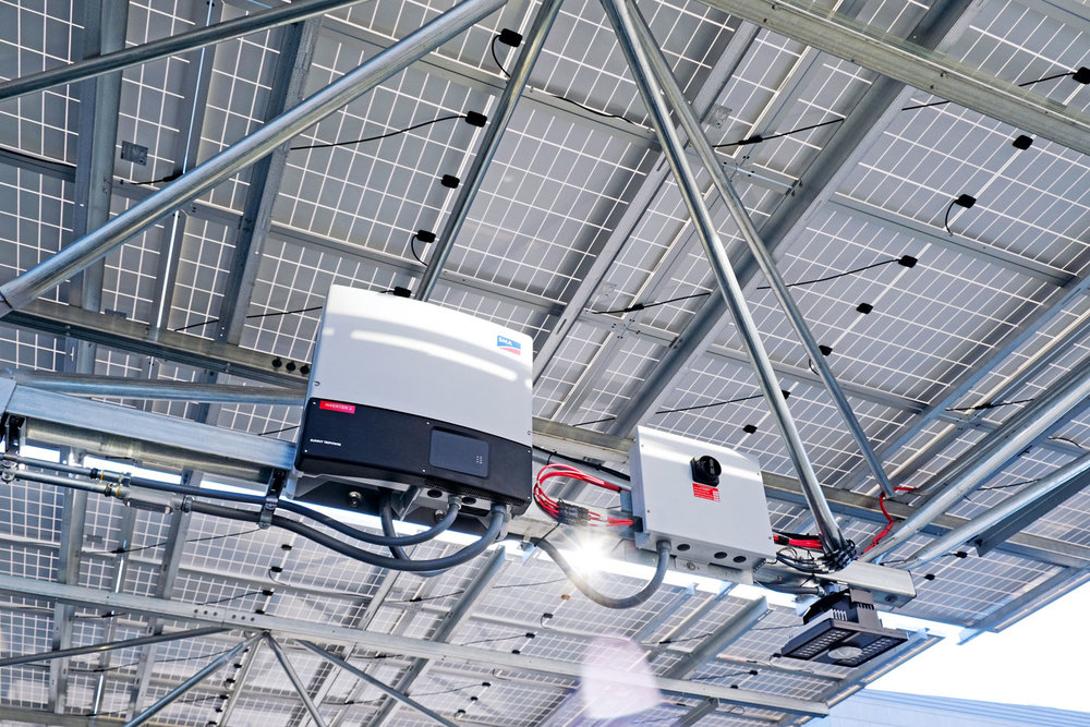 The Fore Street Garage solar canopy in Portland, ME has 7  SMA Sunny Tripower inverters  flying high. Inverters convert DC from the solar panels to AC for usage in homes and offices.