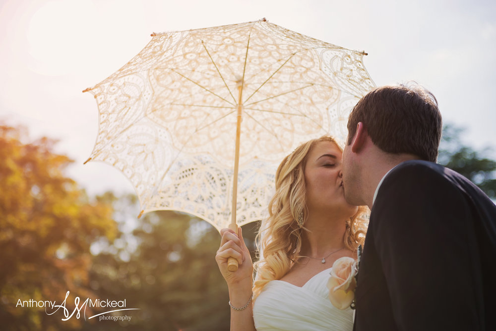 wedding couple under a parasol NJ wedding photography