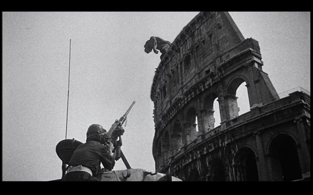 Figure 5: troops fire at Ymir, who has climbed to the top of the Colosseum in  20 Million Miles .