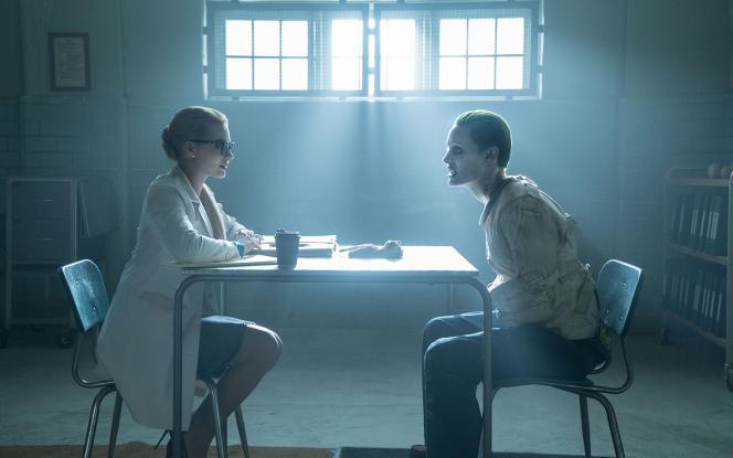 "Figure 2: A ""normal"" Dr. Harleen Quinzel interviews a straight-jacketed Joker."