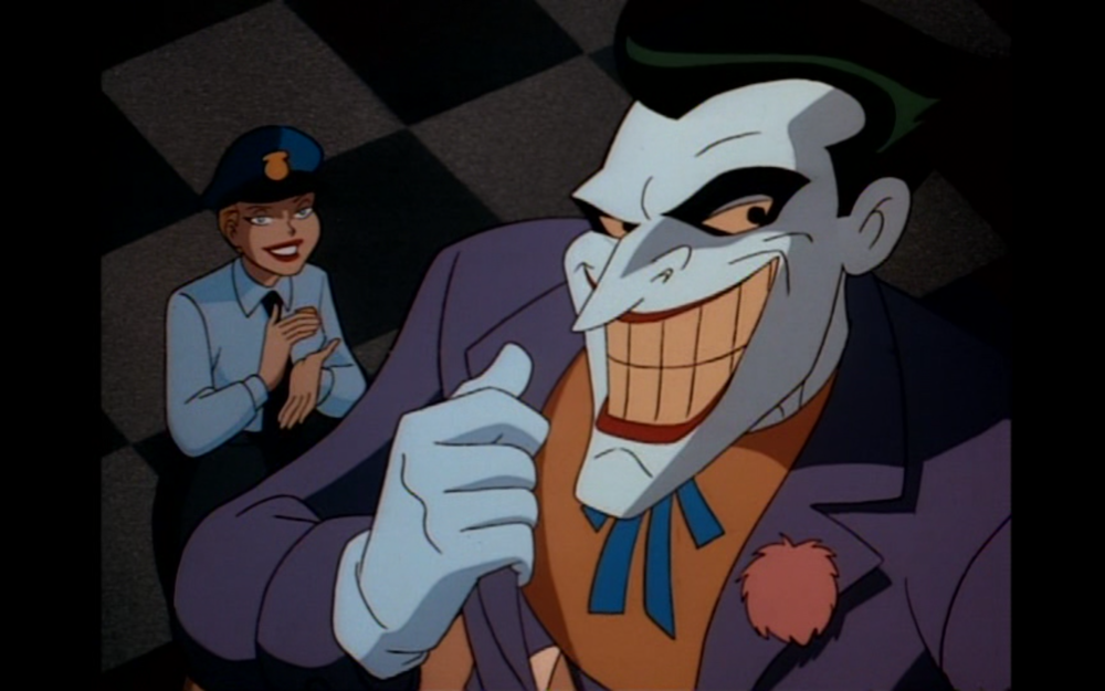 """Figure 5: Harley takes off her harlequin make-up to infiltrate a ceremony in honor of Commissioner Gordon in the Batman: the Animated Series episode """"The Joker's Favor."""" Photo credit: Warner Brothers Animation (DVD)."""