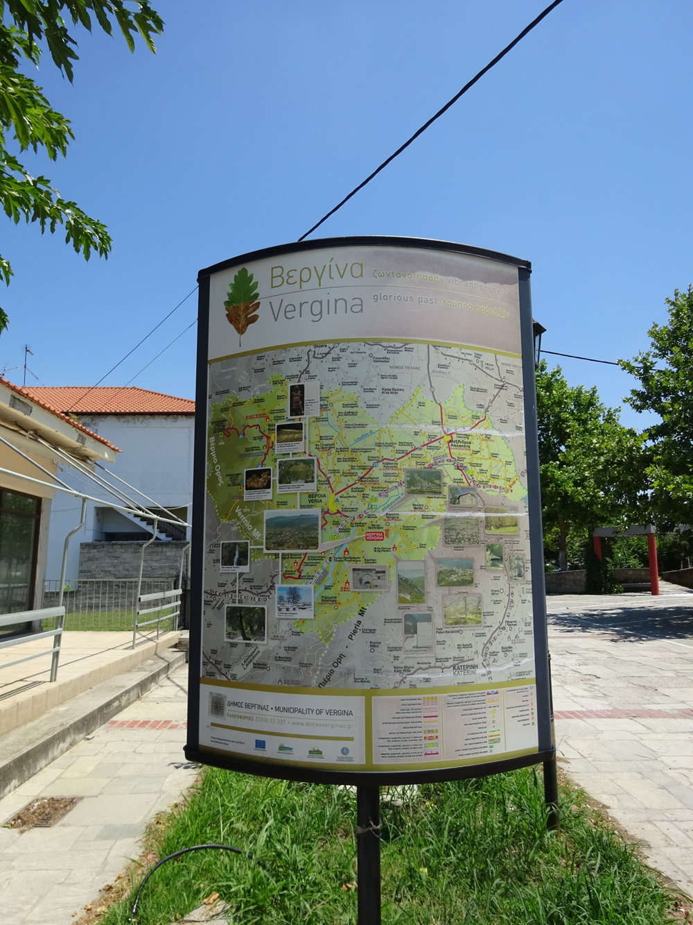 "Figure 4: A sign on a Vergina city sidewalk (Vergina is the home of the Macedonian royal tombs--Alexander the Great's family). Above the map, the city's motto appears in (modern) Greek and in English: ""ζωντανό παρόν/vibrant present, glorious past/λαμπρό παρελθόν"" The ordering of these two phrases demonstrates how Vergina values present and past, but it's significant that the present comes first. Image credit: Vincent Tomasso."