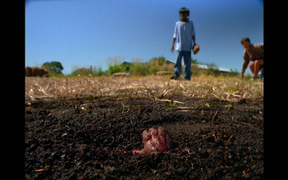 "Figure 1: This grisly image was one of the elements of ""Home"" that prompted the first-ever MA warning on a  The X-Files  episode. Photo credit: screen capture (20th Century Fox Studios)."