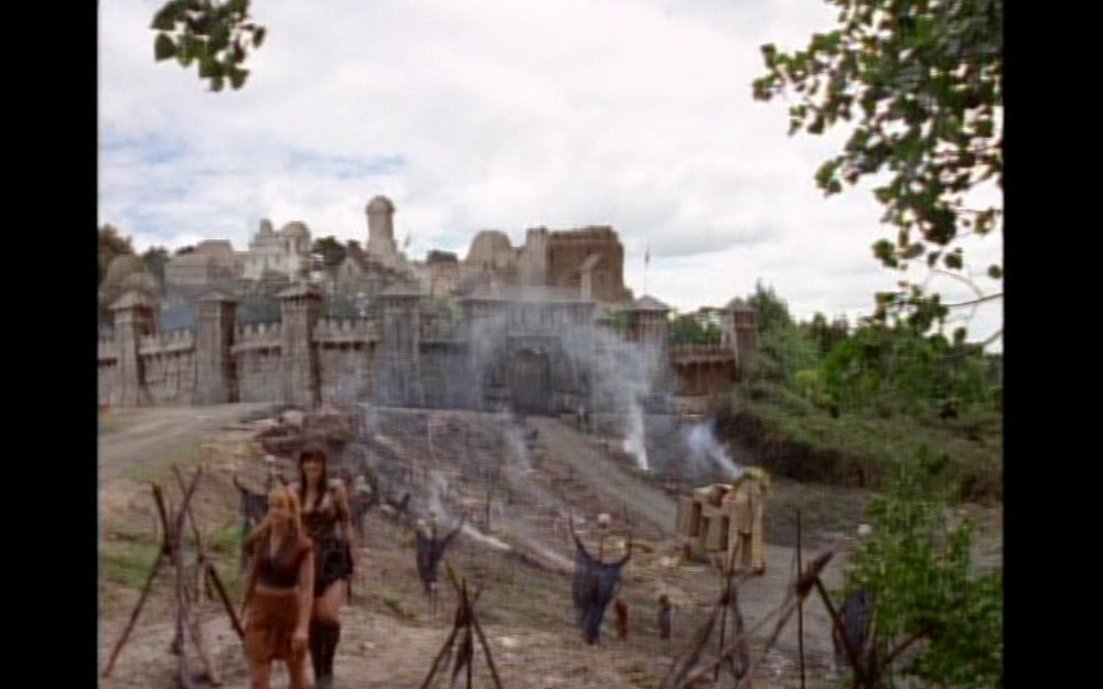 Figure 5: Xena and Gabrielle leave behind the smoking ruins of Troy, the famed wooden horse, and the myth of Helen. In one episode Helen has solved the problem of the Trojan War and the persistent misogynistic illusion of Helen in western culture.