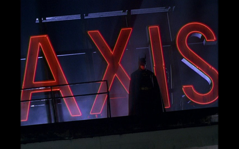 Figure 5: Threatened by the police, Batman leaves the Axis Chemical plant after Napier's fall in Burton's  Batman . Was Burton making an allusion to Hitler and Mussolini in this shot? You decide!