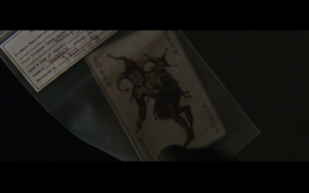 "Figure 6: The Joker's ""calling card"" in  Batman Begins : possibly one of the greatest tags ever in the history of film. And that includes shawarma in  The Avengers  and Howard the Duck in  Guardians of the Galaxy ."