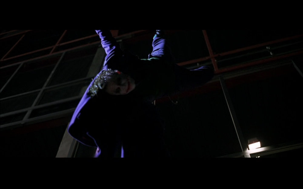 "Figure 9: ""I think you and I are destined to do this forever."" The Joker is saved from falling by Batman in  The Dark Knight ."