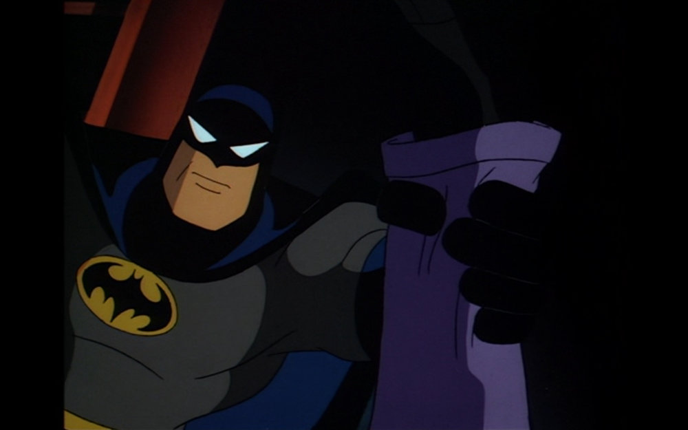 "Figure 10: ""Merry Christmas, Joker."" Batman prevents the Joker from a re-do of his origin story in the  Batman: the Animated Series  episode ""Christmas with the Joker"" (1.38)."