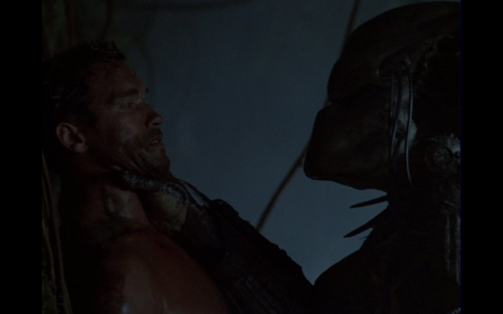 "Figure 2: Dutch goes caveman to face the Predator alone. My favorite Schwarzenegger line from this scene (spoken to himself after his improvised branch weapon breaks over the creature's head): ""Big mistake."""