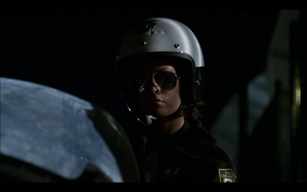 "Figure 3: Cameron takes on the identity of a motorcycle cop in the episode ""The Demon Hand"" (1.7) to steal a severed arm of a T-888 that's in police custody. When Cameron returns home, Sarah sardonically remarks, ""And somewhere in the city a naked cop bleeds in an alley."" Cameron, in this episode and others, has more in common with the T-1000 than the T-800s of previous films."