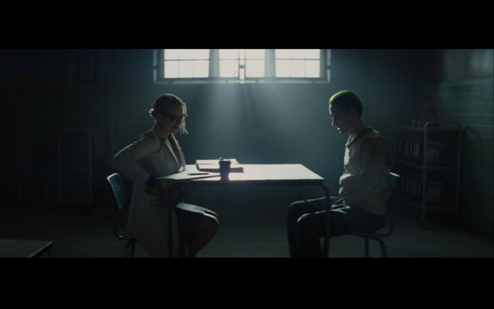 """Figure 2: A """"normal"""" Dr. Harleen Quinzel interviews a straight-jacketed Joker in Suicide Squad. Photo credit: Atlas Entertainment/DC Comics (DVD)."""