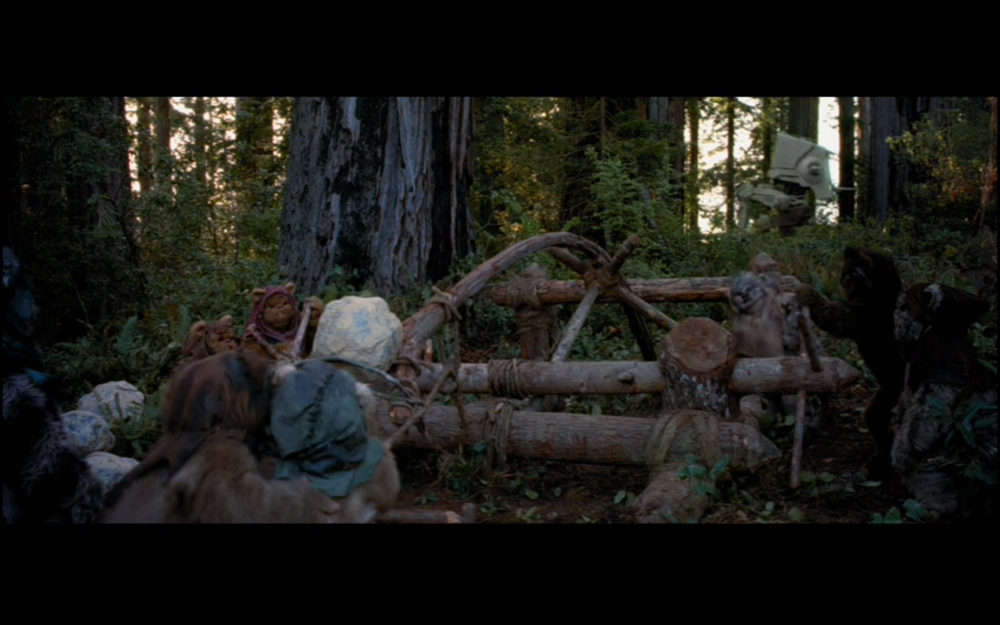"Figure 3: The ""primitive"" Ewoks, here taking on an AT-ST with a catapult(!), defeat the technologically-superior Imperial forces in Return of the Jedi. A similar plot-line will appear in Rogue One. Photo credit: Twentieth Century Fox (DVD)."