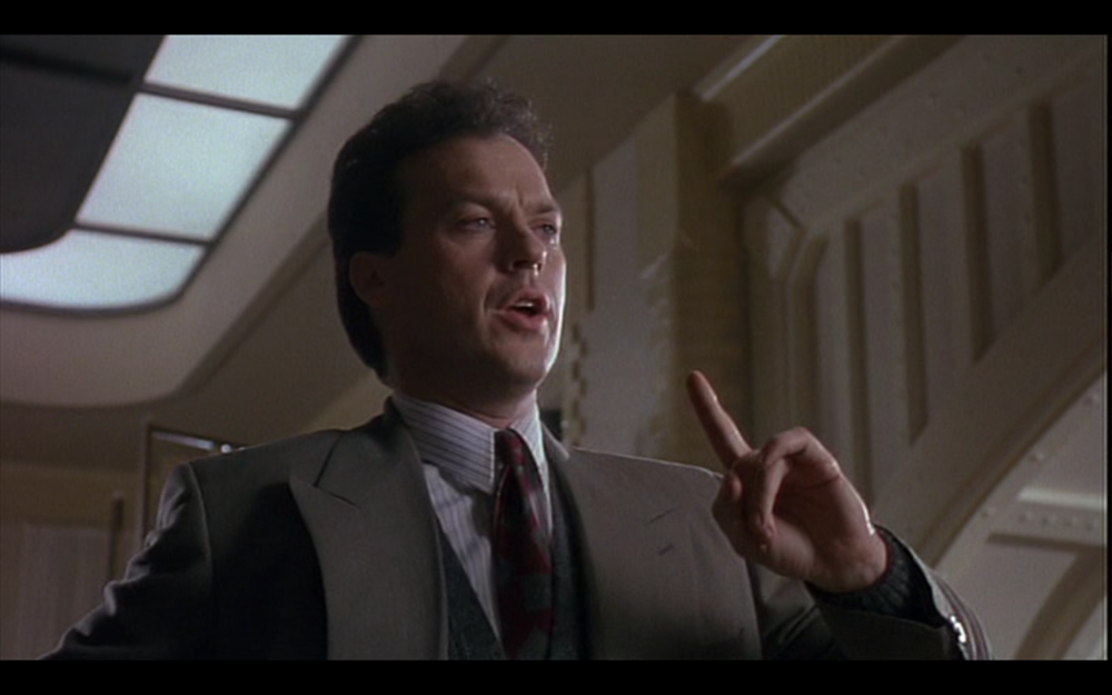 "Figure 1: In Batman (Burton 1989) Bruce Wayne tries to figure out how to tell Vicky Vale he's Batman, practicing silently saying ""I'm Batman"" several times with different facial expressions to himself as if in a mirror. Credit: screen capture (Warner Bros)."
