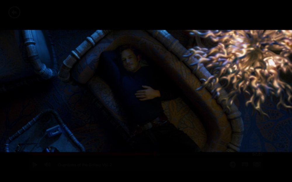 """Figure 2:  Quill lays back listening to """"Brandy"""" on his Walkman in Ego's palace. This is parallel visually to a later flashback scene that depicts Quill and Meredith lying on the grass as they listen to a Walkman (see header image)."""