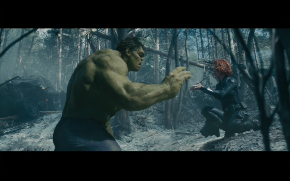 """Figure 3: After incapacitating a HYDRA research base in the opening scene of  Avengers: Age of Ultron  (Whedon 2012), Natasha effects the return of Banner with a """"lullaby"""" (""""Hey, big guy, the sun's getting real low"""") and stroking Hulk's forearm and palm with her fingertips."""