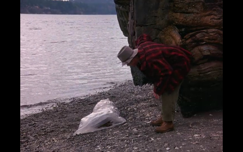 Figure 3: Pete Martell discovers Laura Palmer's body in the opening scene of  Twin Peaks  season 1 episode 1.